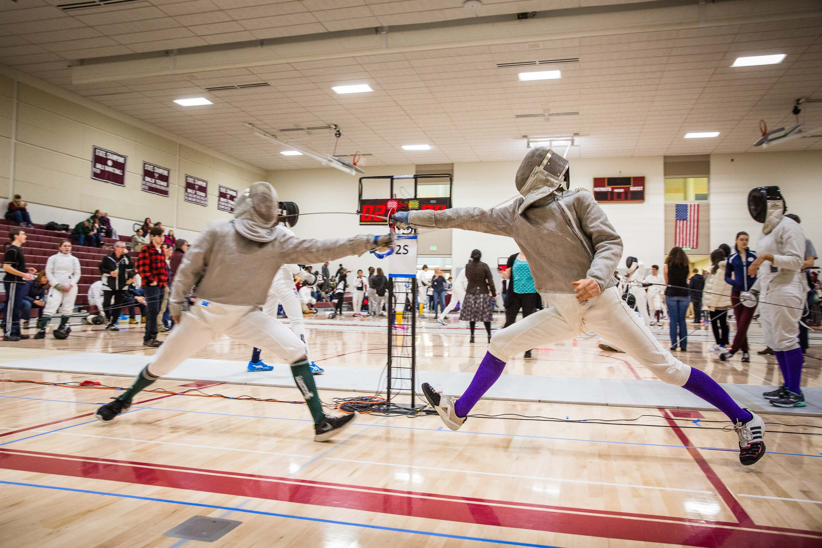 High school sabre fencers