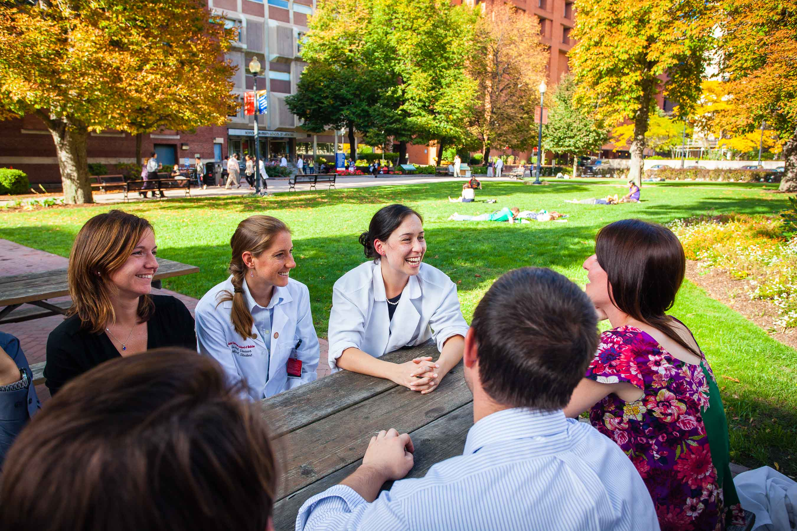 Medical school students having a discussion outside