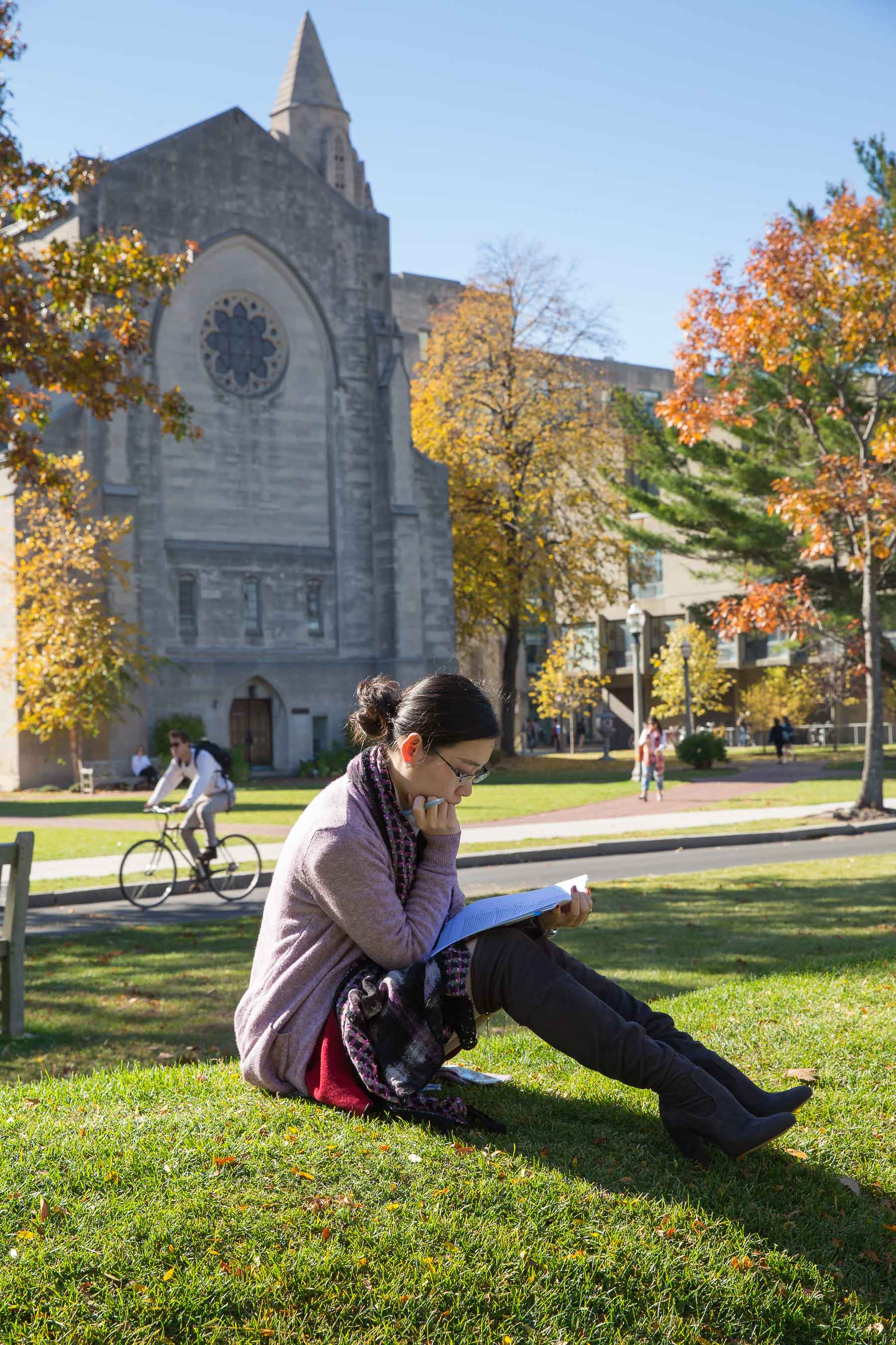 Student studying on BU beach