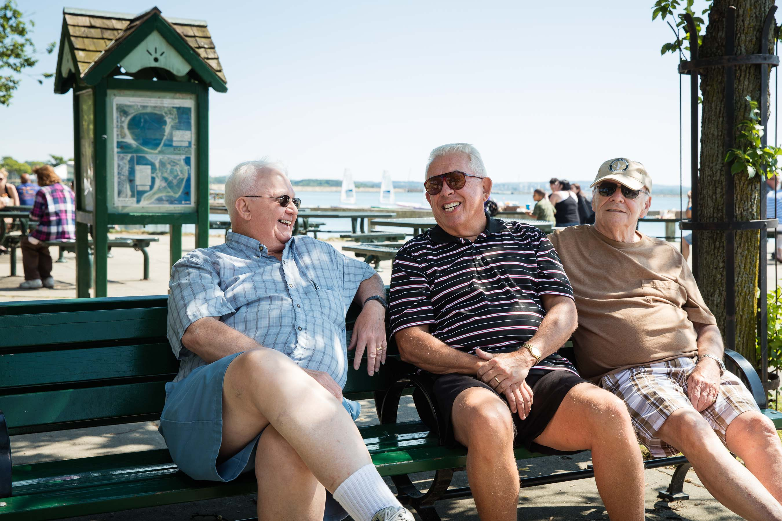 Three older men enjoying a laugh at a park